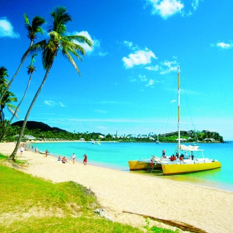 Catamarans and people on Morris Bay Beach Antigua Caribbean